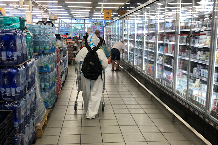 Picture of person in full hazmat gear in Israeli supermarket